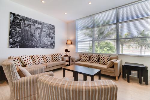 Orange Slice Splendor - Hollywood, FL Vacation Rental